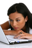 Pensive young woman with a laptop computer Stock Photo