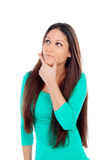 Pensive young woman with long hair Stock Photography