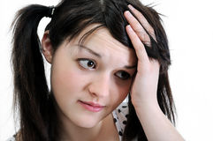 Pensive young woman looking away Stock Images