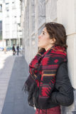 Pensive young woman looking away in the street. Royalty Free Stock Photography