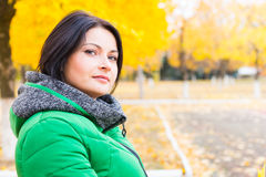 Pensive young woman outdoors in autumn Stock Image