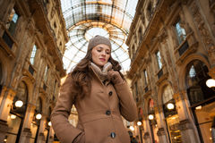 Pensive young woman standing in Galleria Vittorio Emanuele II Royalty Free Stock Image