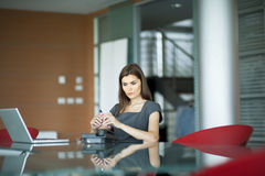 Pensive young woman at work Stock Images