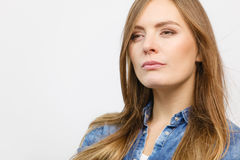 Pensively girl with blue shirt. Royalty Free Stock Image