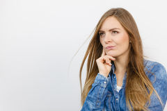 Pensively girl with blue shirt. Stock Photography