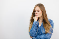 Pensively girl with blue shirt. Stock Photo