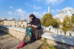 Pensively looking Middle Eastern Lady sitting in Park Stock Photo
