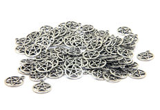 Pentacle Amulets. Scattered lot of unadorned pentacles lay isolated on white Stock Photos