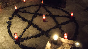 Pentacle demon candles. Pentacle demon with candles in celebration witchcraft, halloween and fear Royalty Free Stock Photo