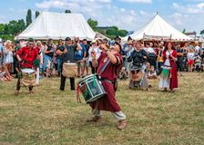 The Pentacle Drummers, Tewkesbury Medieval Festival, England. The Pentacle Drummers, the premier Sussex drumming troupe, playing their rhythmic music on snare stock images