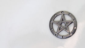 Pentacle on white background. Pewter pentacle on white background Stock Photos