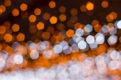 Pentagon bokeh. Orange pentagon shape bokeh background stock images