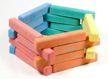 Pentagon from childrens colored chalk. On white Royalty Free Stock Photos