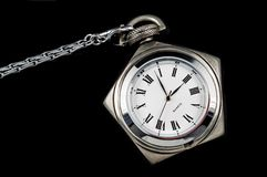 Pentagon pocket watch. Pentagoned steel pocket watch on black background Stock Photo