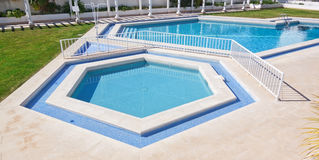 Pentagonal summer pool outside. Royalty Free Stock Photos
