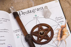 Pentagram - Book Of Shadows Wicca. Wiccan tools on top of book of shadows with wand shell and pentacle incense burner Stock Photography