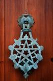 Pentagram knocker. On a wooden door Stock Photo