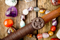 Pentagram symbol on wand on circles of healing crystals Stock Photography