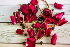 Pentals of red roses and a necklace Stock Images
