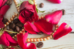 Pentals of red roses and a necklace Stock Photo