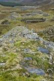 Pente abandonnée pour la carrière d'ardoise, Pays de Galles du nord. Photos stock