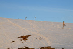 Pente de ski au lever de soleil Photo stock
