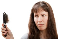 Pente do cabelo da perda na mão das mulheres Imagens de Stock Royalty Free