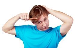 Pente do homem seu cabelo Imagem de Stock Royalty Free