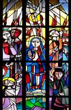 Pentecost, Descent of Holy Spirit. Stained glass window in the Saint Lawrence church in Kleinostheim, Germany stock photography