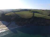 Pentewan Sands in Cornwall. An aerial shot of the cliffs or Pentewan Sands in Corwall South West England. The shot was taken by a DJL Inspire 1 drones. The calm Stock Image