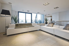 Penthouse apartment. Living room of penthouse apartment with huge corner sofa stock photography
