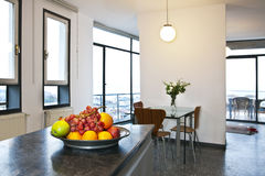 Penthouse Apartment. A view with a fruit plate in the foreground of a penthouse apartment royalty free stock images