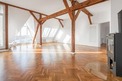 Penthouse apartment interior , loft room with stove, parquet fl royalty free stock photo