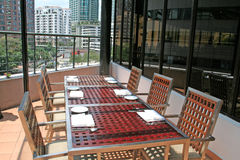 Penthouse dining. Penthouse outdoor dining, city view royalty free stock image