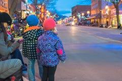 Children watch as the Penticton Santa Claus Parade begins. Penticton, British Columbia/Canada - December 3, 2016: children look down Main street as the Santa Stock Photos
