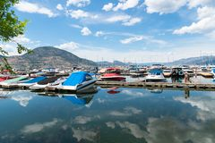 Boats and docks in summer at the Penticton Marina and Yacht Club royalty free stock photo