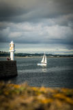 Penzance Lighthouse and sailboat Royalty Free Stock Photos