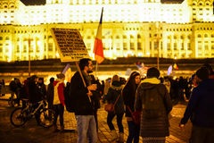 Peolpe protesting with messages, Bucharest, Romania Royalty Free Stock Photo