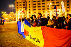 Peolpe protesting with romanian flag, Bucharest, Romania Royalty Free Stock Photo