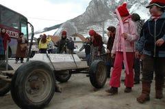 Peolple celebrating the winter ending carnival. RIMETEA - FEB 28: Local unidentified villagers of Rimetea (Torocko) attending a unique show, the carnival with Stock Image