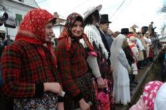 Peolple celebrating the winter ending carnival. RIMETEA - FEB 28: Local unidentified villagers of Rimetea (Torocko) attending a unique show, the carnival with Royalty Free Stock Photo