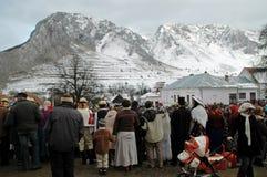 Peolple celebrating the winter ending carnival. RIMETEA - FEB 28: Local unidentified villagers of Rimetea (Torocko) attending a unique show, the carnival with Stock Images