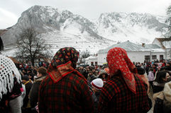 Peolple celebrating the winter ending carnival. RIMETEA - FEB 28: Local unidentified villagers of Rimetea (Torocko) attending a unique show, the carnival with Royalty Free Stock Images