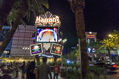 Peolple at entrance of  Harrah`s. LAS VEGAS - JUNE 15: people at Harrah`s neon sign on June 15, 2012. Opened in 1973 as the Holiday Casino, the property was Stock Photography