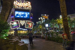Peolple at entrance of  Harrah`s. LAS VEGAS - JUNE 15: people at Harrah`s neon sign on June 15, 2012. Opened in 1973 as the Holiday Casino, the property was Royalty Free Stock Photo