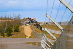Peolple standing by the fence. People standing by the fence of Vantaa airport in Finland Stock Image