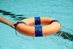 Peolple throw Life ring floating to someone. In the pool Royalty Free Stock Photo