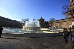 Peolple walking in front of Castello Sforzesco, one of the main Royalty Free Stock Photos
