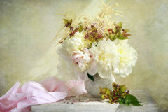 Peonies. Beautiful white peonies on the table Stock Photography