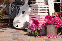 Peonies in the bucket and a white guitar Stock Photography